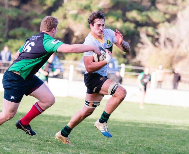 Marist's Liam Udy-Johns evades the tackle of Bykel Sleeman, of the Barbarians, at ...