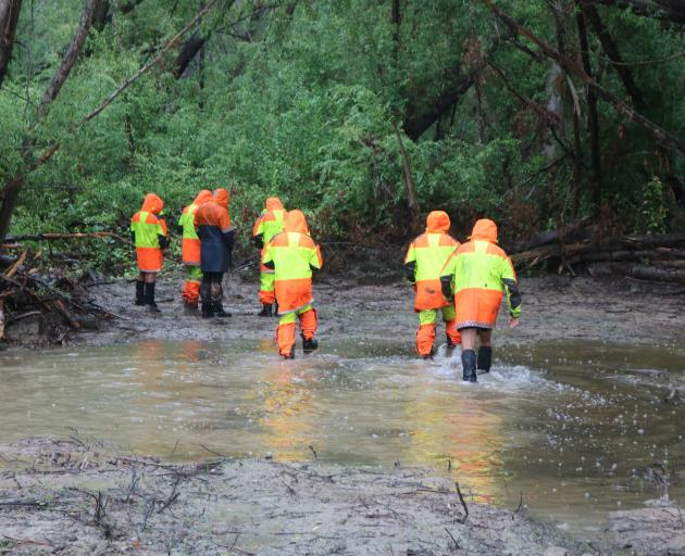 A Fiordland Search and Rescue team takes part in a search near the Manuherikia River a year after...