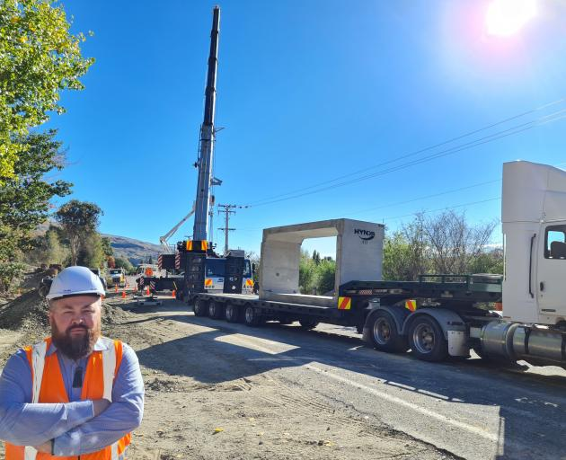 NZ Transport Agency Central Otago senior network manager Robert Choveaux stands in the foreground...