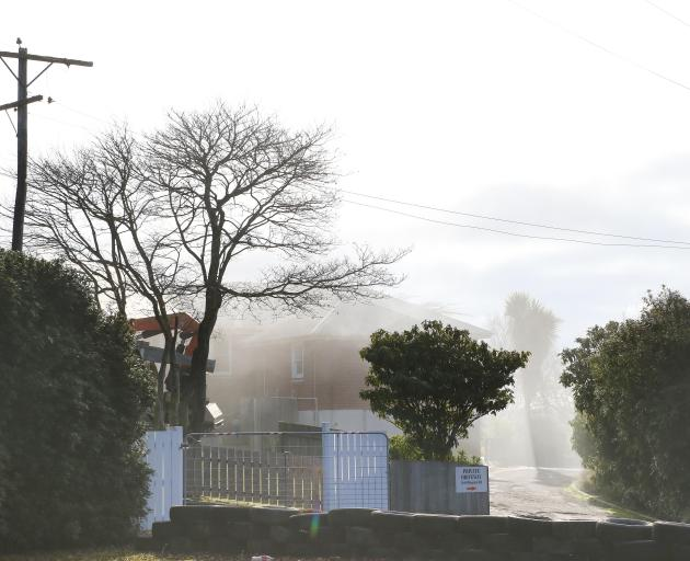 Smoke from a blaze blankets a property in Balclutha today. Photo: John Cosgrove