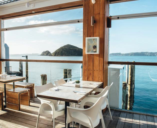 Charlotte's Kitchen, perching on the main pier in Paihia, offers Asian-influenced dishes. Photo:...