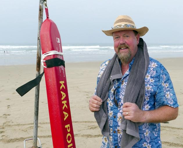 Paul Barron, of Dunedin, dries off after his inaugural Kaka Point Surf Life Saving Club Midwinter...