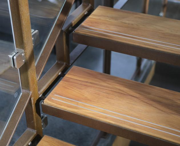 Aluminium strips embedded in the stair treads ensure a safe footing.