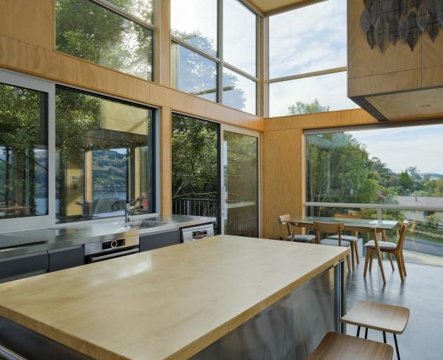 The kitchen opens to a deck surrounded by native bush. Almost all furniture, including the...