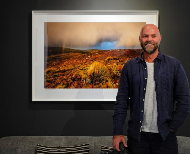 Christopher Thompson exhibits one of his photos from the trip in his Picture Lounge studio. PHOTO...