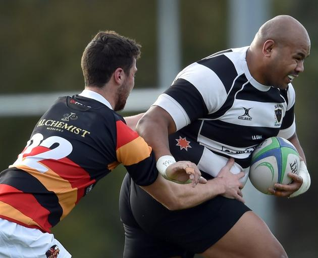 Southern prop Michael Mata'afa tries to break the tackle of Zingari-Richmond replacement back...