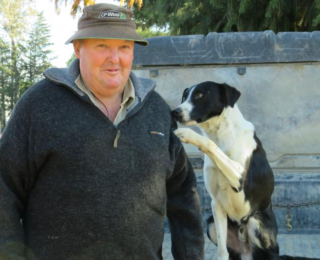 Mark Copland at home on farm with Don, after a successful dog trial season.