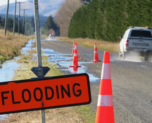 A sign warns of flooding on the Arundel Rakaia Gorge Rd, Inland Scenic Route 72. PHOTO: TONI...