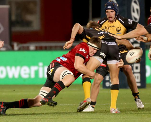 Tom Sanders from the Crusaders tackles Domingo Miotti from the Western Force. Photo: Getty Images