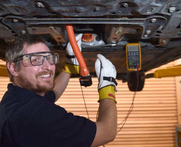 Otago Polytechnic automotive engineering senior lecturer and technician Elliot King tests...