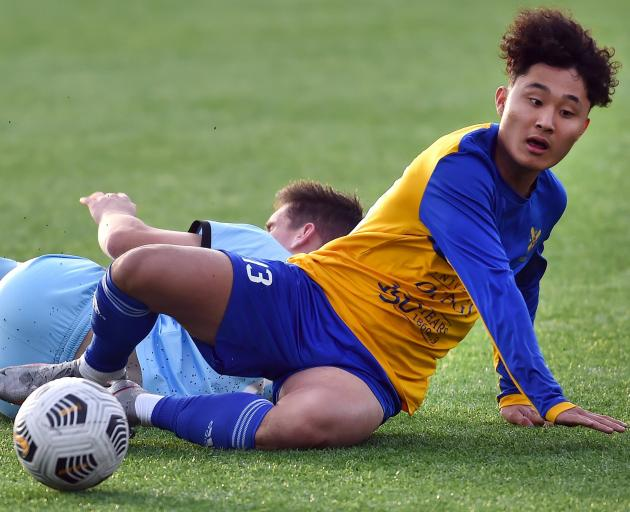 Yun Sung Chang looks to get off the ground after a tussle with South City ...