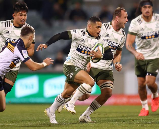 Aaron Smith of the Highlanders makes a line break during the round five Super Rugby Trans-Tasman...