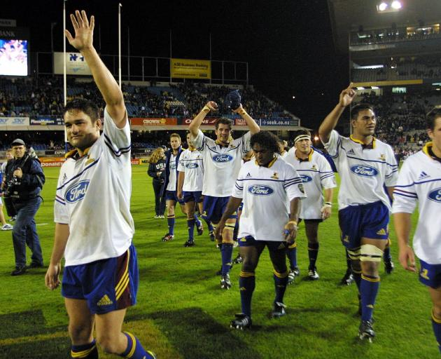 Captain Taine Randell leads the Highlanders off Eden Park in 2002 after claiming the first win at...