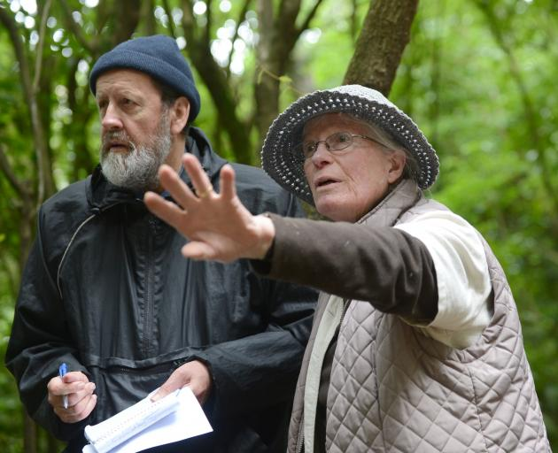 In this 2015 photo, Maori Rd resident Pat Petersen tells John Gibb her concerns about cutting and...