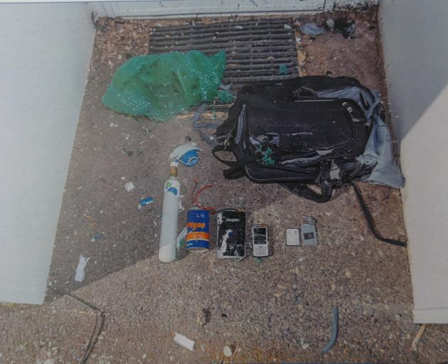 Police sifted through the insides of the hoax bomb after it had been neutralised.