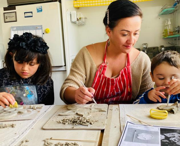Raewyn Smith with two of her children Victoria and Carlos took part in a recent pottery workshop...
