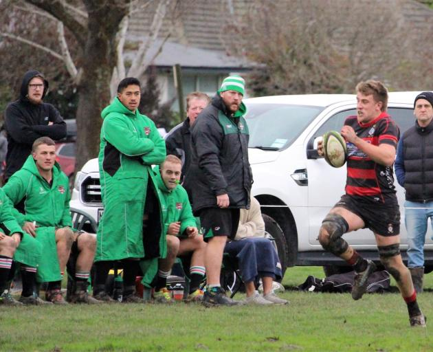 Christchurch's Nathan Evans makes a break past unimpressed Marist Albion reserves. Photo:...