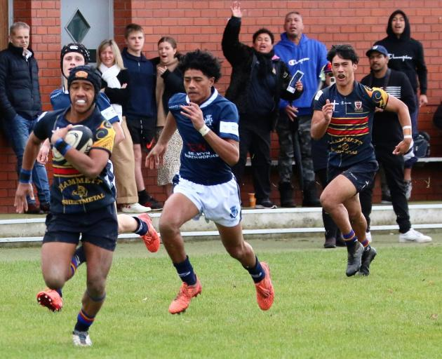 St Thomas' Simon Uliano heads for the line to open the scoring at St Andrew's College after...