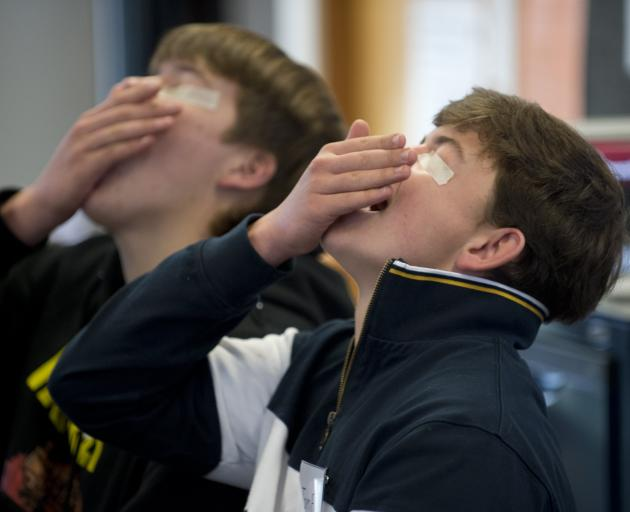 Trying their best in a blind insect eating challenge are Charles Engelbrecht (left) and Tom...