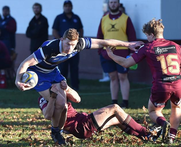Kaikorai playmaker Ben Miller is tackled by Alhambra-Union winger Peceli Malanicagi at the North...