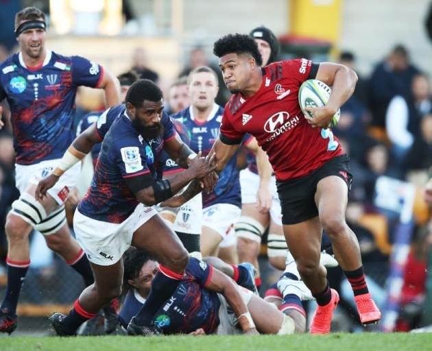 Crusaders winger Leicester Fainga'anuku makes a break during their game against the Rebels in...