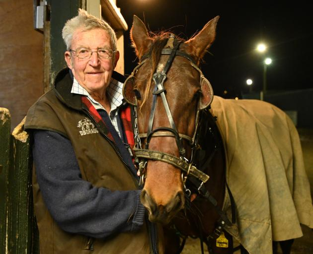 Trainer Lionel Sinnamon, of Omakau, with Southern Starr before race 2 at Forbury Park last night....