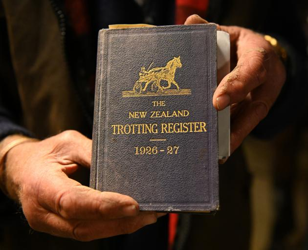 Lionel Sinnamon holds a 1926-27 Trotting Register, the era the family began fielding winners at...