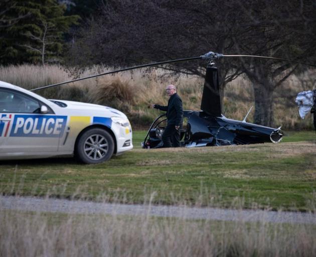 Police at the scene of the crash. Photo: George Heard