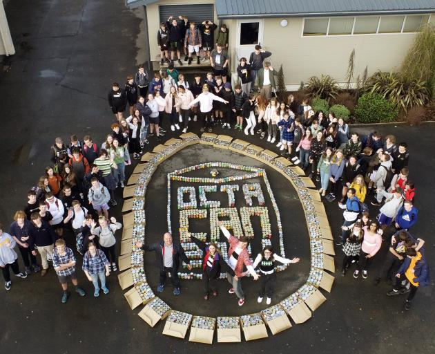 Taieri College pupils stand with 1800 cans collected for Octacan. PHOTO: STEPHEN JAQUIERY
