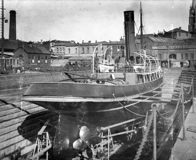 The salvage tug Dunedin nears completion at Stevenson and Cook's dock in 1914. It would later tow...