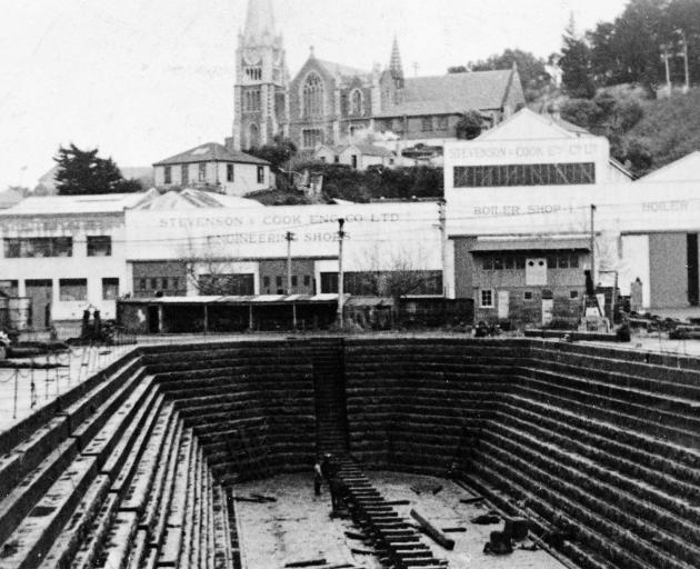 The empty Port Chalmers' dock in 1914 with Stevenson and Cook's multiple workshops in the...