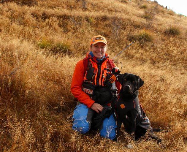 Handler Bridget Martin and Labrador Spaniel search and rescue dog Stag. PHOTO: DANIEL ALVEY