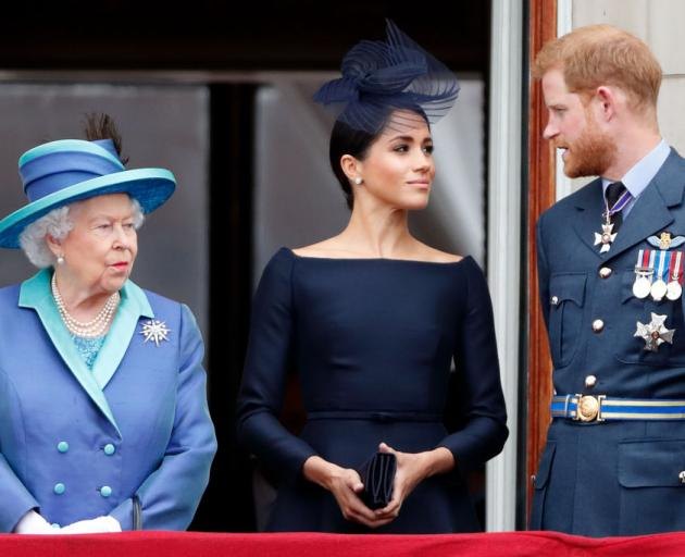 The Queen, Meghan, Duchess of Sussex and Prince Harry at Buckingham Palace in 2018. Photo: Getty...