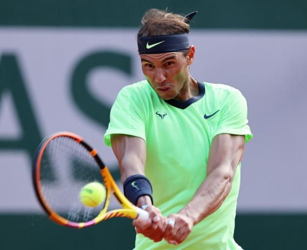 Rafael Nadal plays a backhand during his quarterfinal win this morning at Roland Garros. Photo:...