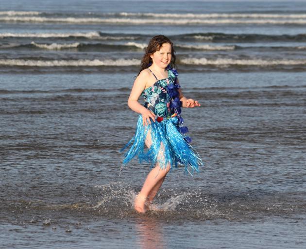 Returning from her swim at Taramea Bay is Lakisha Mennell (9).