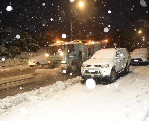 A Fulton Hogan truck ploughs snow in Taieri Rd this morning. Photo: Stephen Jaquiery