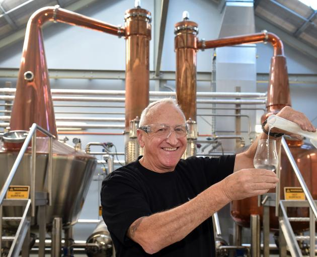 Cyril Yates stands in front of the New Zealand Whisky Collection's stills at Speight's Brewery in...