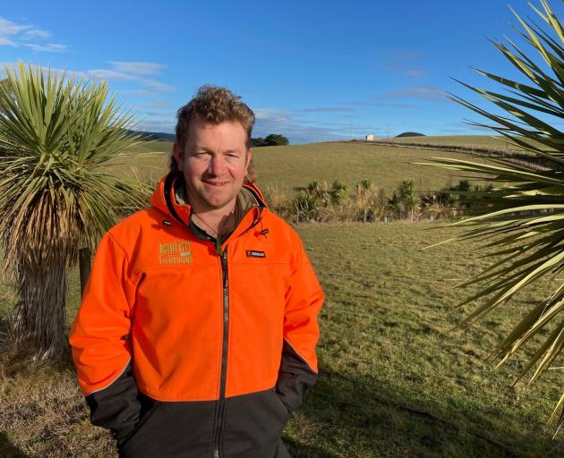 Glen Riley, of Habitat Restorations Aotearoa, at the Sinclair Wetlands with a maturing riparian...