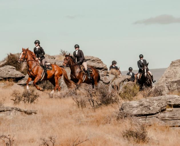 Leading a pack of riders through schist rock at an Otago Hunt Inc event in Middlemarch in April this year are Tori Brown (left) and Annabelle Dean. Photo: Kerri Back Photography