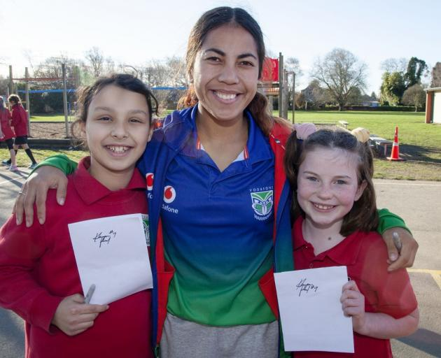 NZ Warriors NRL women's premiership player Kanyon Paul with Taleen Msalen (left) and Bethany...