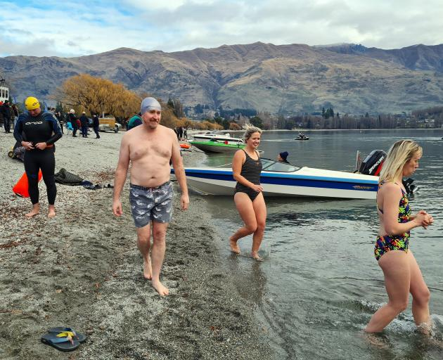 Swimmers head for the lake at the Wanaka midwinter fundraiser for the Wanaka Foodbank yesterday....
