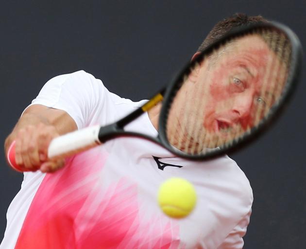 German tennis player Philipp Kohlschreiber plays a shot against Serbian Filip Krajinovic at the...