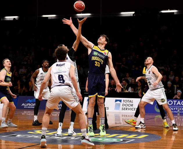 Otago Nuggets centre Sam Timmins wins the tip-off during the game against the Huskies in Dunedin...