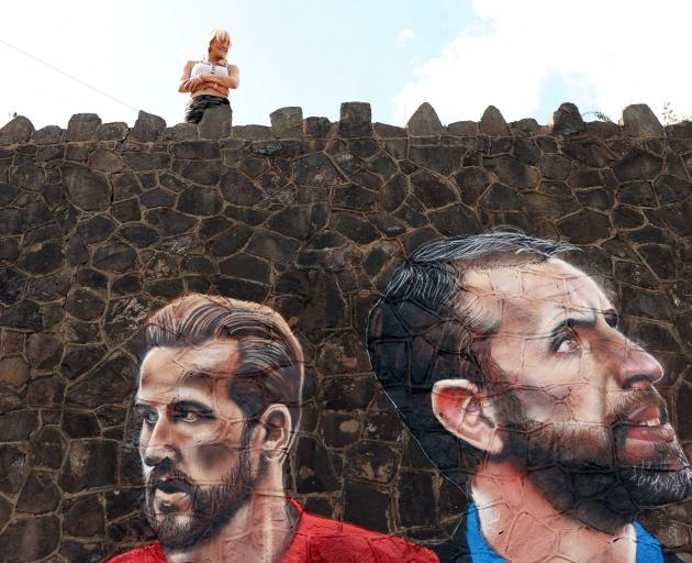 England football captain Harry Kane (left) and manager Gareth Southgate are depicted in a giant...