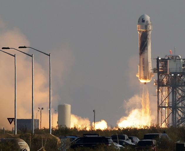 Billionaire businessman Jeff Bezos is launched, with three crew members, aboard Blue Origin's New...