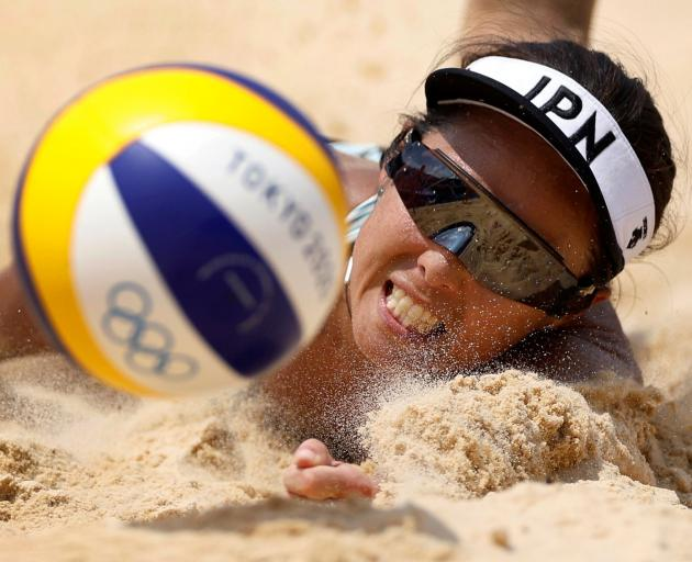 Megumi Murakami competes for Japan against Switzerland in the beach volleyball competition.