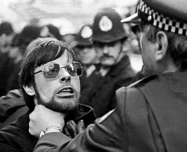 An anti-tour protester is confronted by a police officer during a 1981 demonstration in Dunedin....