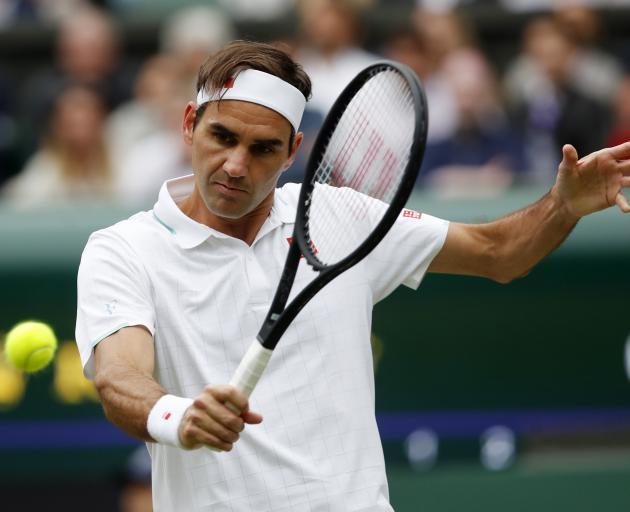Roger Federer refocused after a break in the weather. Photo: Reuters