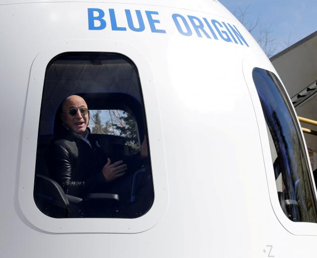The world's richest man, Jeff Bezos, will fly from a desert site it Texas on an 11-minute trip to...