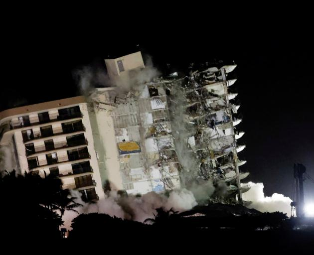 The partially collapsed Champlain Towers South building was demolished on July 4 for safety...
